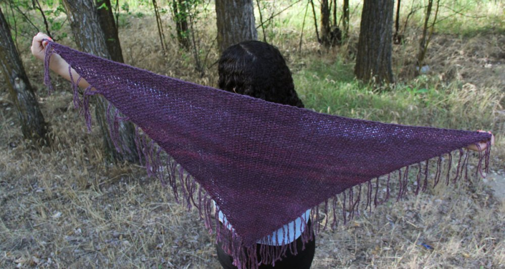 Large enough to wear as a shawl or scarf.